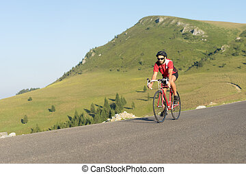 cyclist on road bike