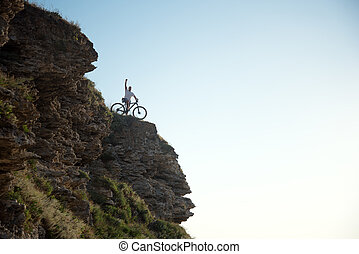Cyclist on the hill