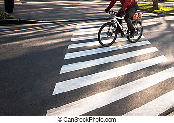 Cyclist on the zebra crossing in the city