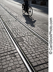 Cyclist on Tram Track in Geneva, Switzerland