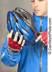 Cyclist Puts On Helmet 4