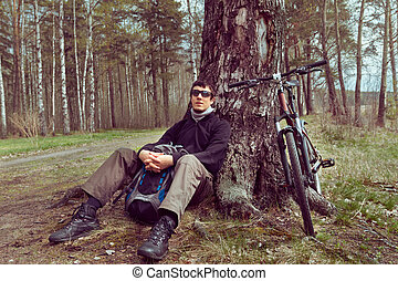 Cyclist rests in the forest