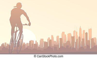 Cyclist rides in big city.
