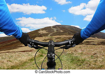 cyclist rides on a mountain road