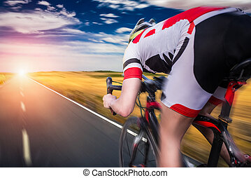 Cyclist rides on bicycle, speed effect