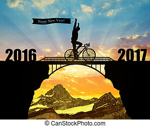 Forward to the New Year 2017 - Cyclist riding across the...