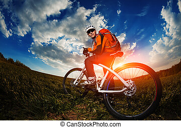 cyclist riding bike on a nature trail in the mountains.