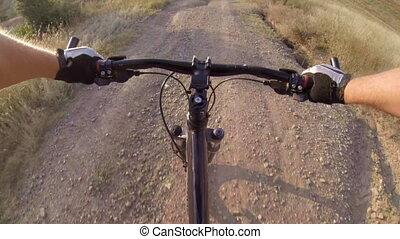 Cyclist riding mountain bike down the trail, POV, GoPro...