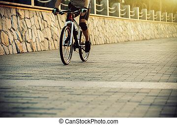 cyclist riding mountain bike in the coast trail