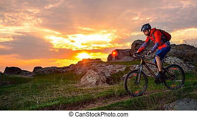 Cyclist Riding Mountain Bike on the Spring Rocky Trail at...