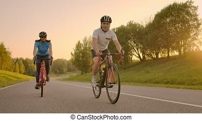 Cyclist Riding On Road Bike Rear View.Cycling Men Pedalling...