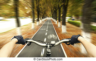 riding - Cyclist riding on the bike path