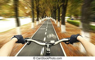 riding - Cyclist riding on the bike path