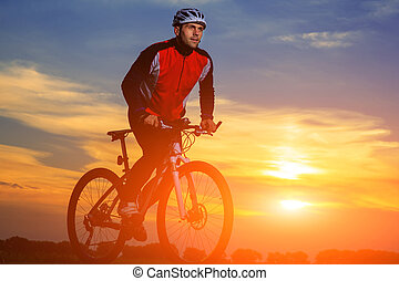 Cyclist Riding the Bike