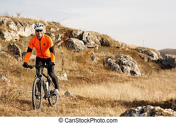 Cyclist Riding the Bike on the Beautiful Spring Mountain Trail