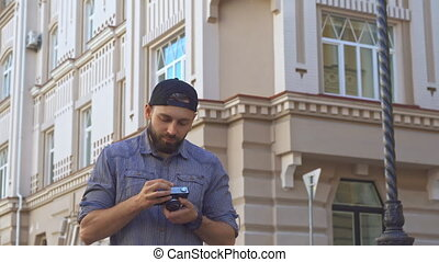 Cyclist takes a picture on the street
