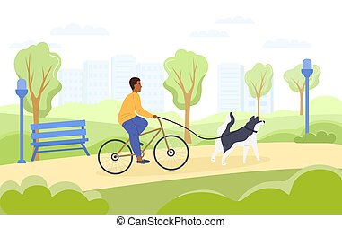 Cyclist taking his dog for a run on a lead