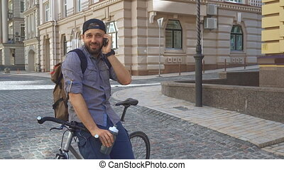 Cyclist talks on the phone on the street