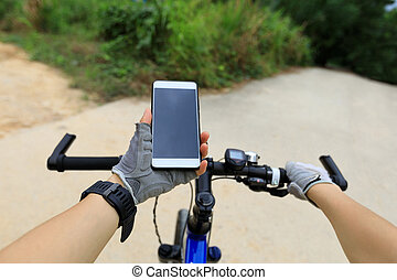 cyclist use smartphone for navigation in front of the Crossroads