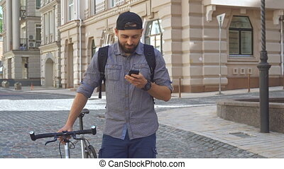Cyclist uses cellphone on the street