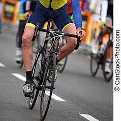 cyclist without a arm with the bike in the city race