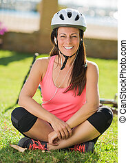 Cyclist Woman Listening To Music, Outdoors
