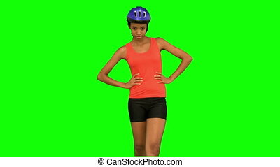 Cyclist woman standing on green scr