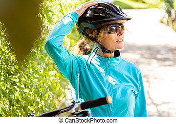 cyclist woman with helmet and mountain bike