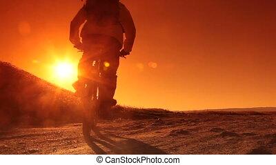cycliste, levers de soleil