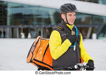 cycliste, mâle, courrier, livraison, sac, utilisation, talkie-walkie