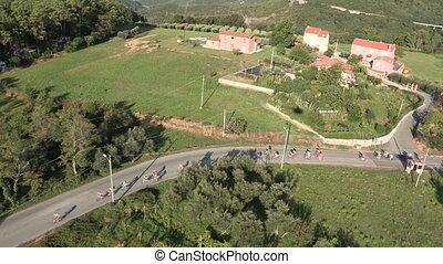Cyclists along a curvy road