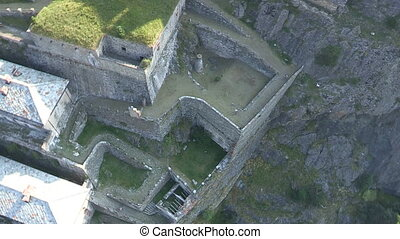 Cyclists going downhill in a castle