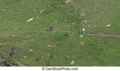 Cyclists going downhill