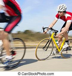 Cyclist at high speed in pursuit. Motion blur panned image