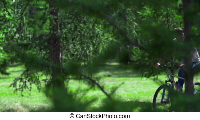 Cyclists Working Out - Two cyclists passing by the camera in...