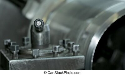 the process of grinding large metal cylindrical parts in...