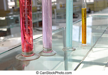 Cylinders with substances in a chemistry laboratory...