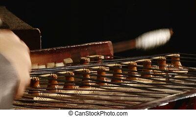 Cymbal, dulcimer, hands
