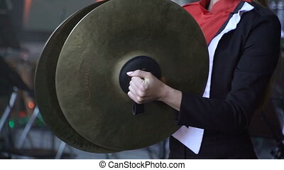 Cymbal. Playing a musical instrument