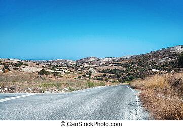 Cyprian mountain road wild rocky landscape, bush on rocks