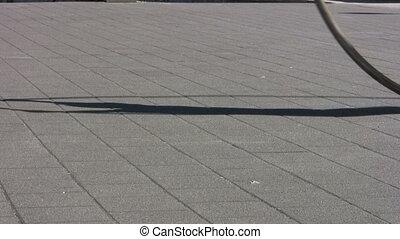Cyr Wheel - Sidewalk Circle Action - A man using a Cyr Wheel...