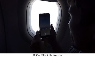 człowiek, prospekt, doprowadzenia, telefon, airplane okno, obraz, lot, młody