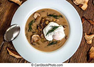 Czech traditional soup kulajda with dill nad mushroom and poached egg