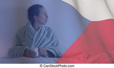 Animation of Czech flag waving over a sick Caucasian woman lying in bed coughing drinking tea. Global coronavirus pandemic concept digitally generated image.