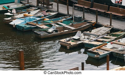Czech Republic, Prague. Old Small Boats Parked in the Dock -...