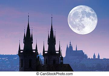 Czech Republic, Prague, silhouette of high section of Tyn church at night.