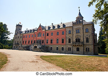 CZECH REPUBLIC, SYCHROV - AUGUST 9, 2015: Neo Gothic castle Sychrov near town with same name Sychrov. Pink facade castle and beautiful park in english style. Liberec Region, Bohemian Paradise, Europe