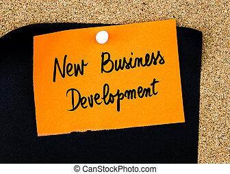 développement, business, note, écrit, papier, orange, nouveau