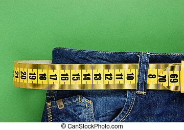 dżinsy, metr, odchudzając, zielone tło, pasek