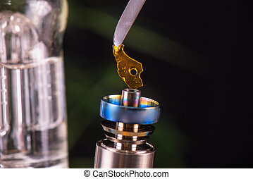 Dabbing tool with small piece of cannabis oil aka shatter - medical marijuana concentrates concept